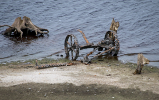 PICS: Retreating water in Wicklow lake reveals old house and farm machinery