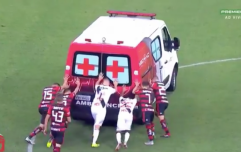 Ambulance breaks down on football pitch, players help to push it off