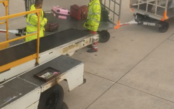 WATCH: Manchester Airport release statement after baggage handlers toss luggage without a care in the world