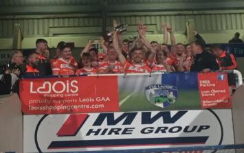PICS: A stretcher wasn't going to stop this Laois hurler celebrating with his team