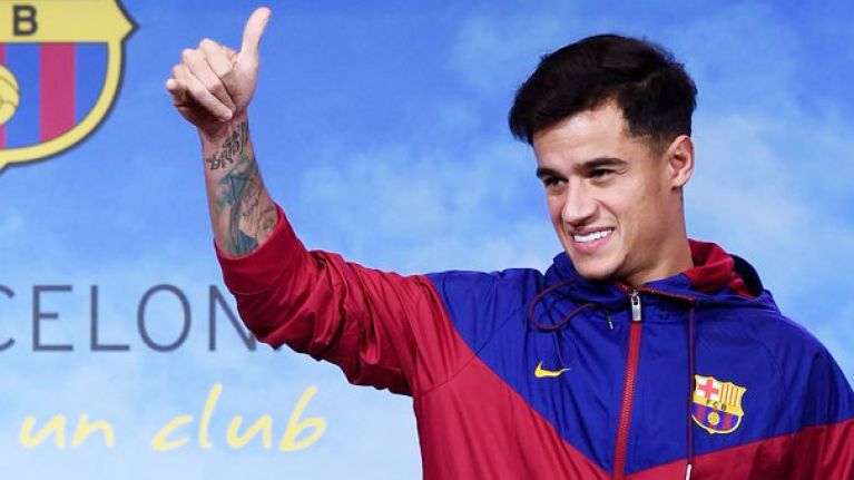 Everyone's noticed the same thing about Barcelona's unveiling photo of Coutinho