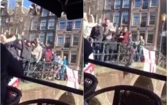 WATCH: English fans filmed launching full cups of booze onto boatful of people and diving into canal in Amsterdam