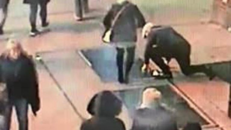 WATCH: Man proposes, woman says yes, man drops engagement ring down grate in the street