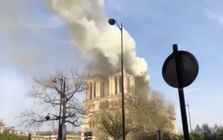 The moment Notre Dame's world-famous spire fell