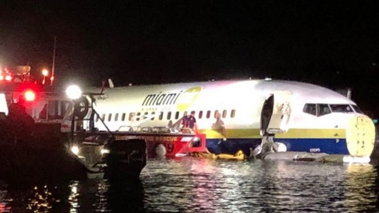 Boeing 737 skids into river after attempting to land during thunderstorm