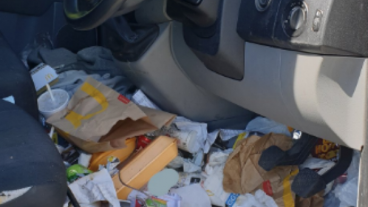 Driver fined by police because their car was so messy that it's dangerous on the roads
