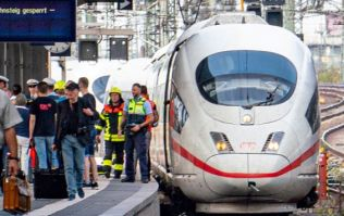 Boy, 8, dies after he and his mother are deliberately pushed onto train tracks in Germany