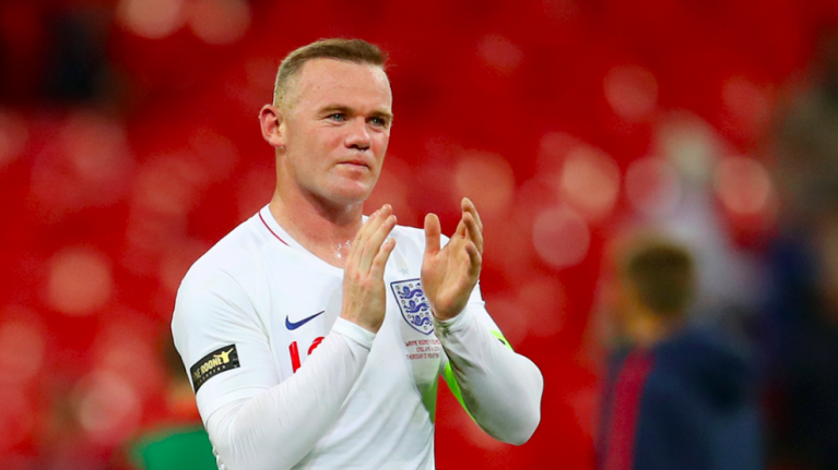 Wayne Rooney's mugshot released after his arrest for 'public intoxication and swearing'