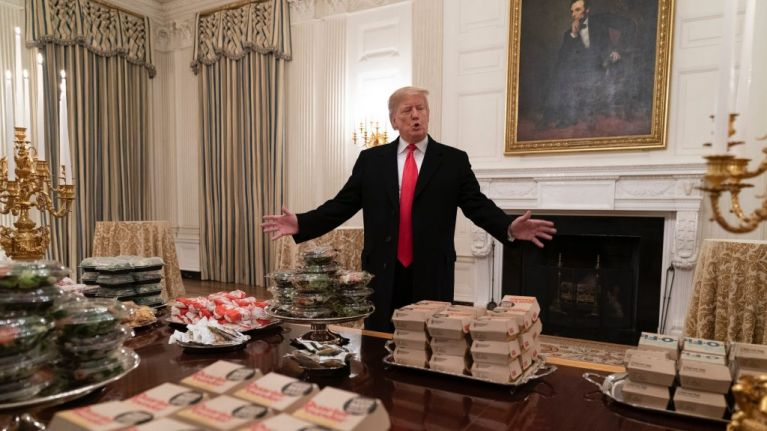 Donald Trump welcomes college football champions to fast food banquet after government shutdown