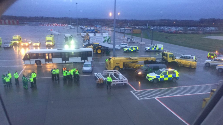 Passengers quarantined by masked staff after 'coughing sickness' outbreak on flight to Gatwick