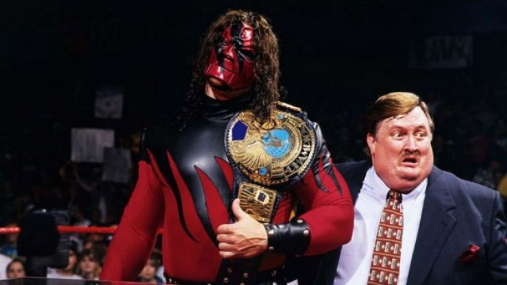 WWE wrestler Kane dresses up as The Cat In The Hat to read to some presumably terrified kids