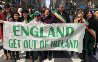 Simon Coveney absolutely slates Mary Lou McDonald after she stands next to anti-British flag in parade