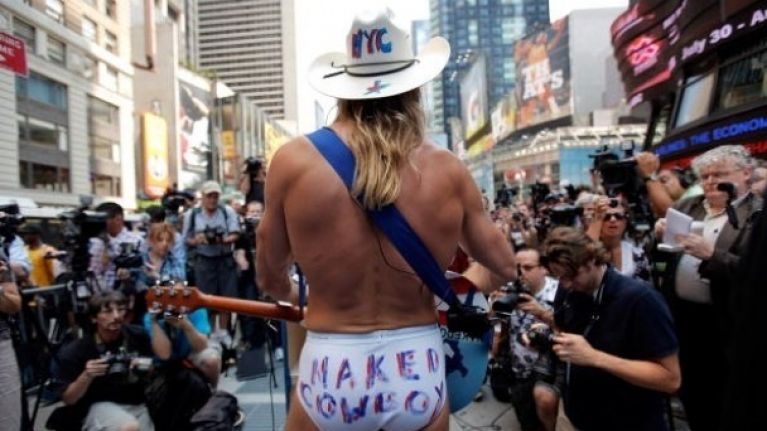 Naked Cowboy threatens to sue Naked Cowgirl