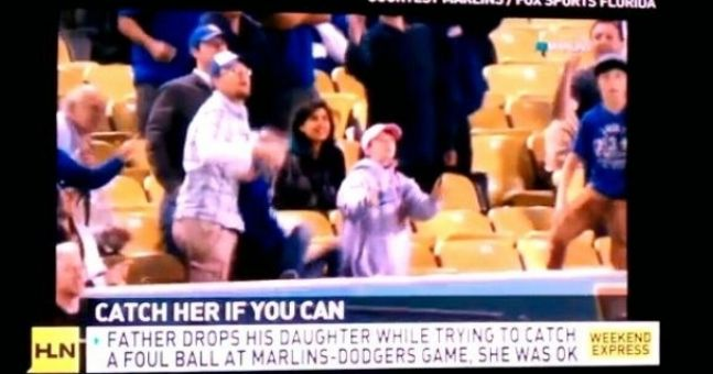 Video: Father drops daughter while trying to catch foul ball