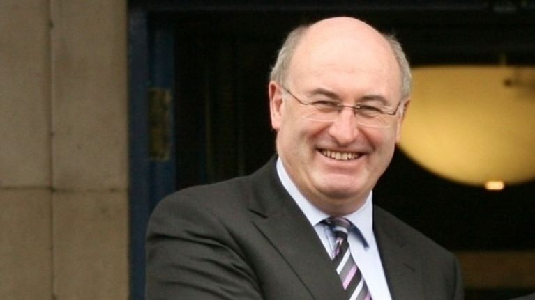 Phil Hogan seeks sanctuary in church as protestors hold rally outside