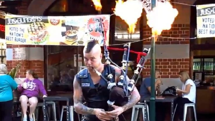 Australian busker performs AC/DC's Thunderstruck on flaming bagpipes