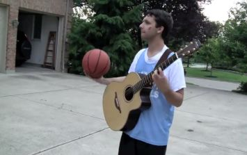 Video: Can you play a guitar while dribbling a basketball? This guy can...