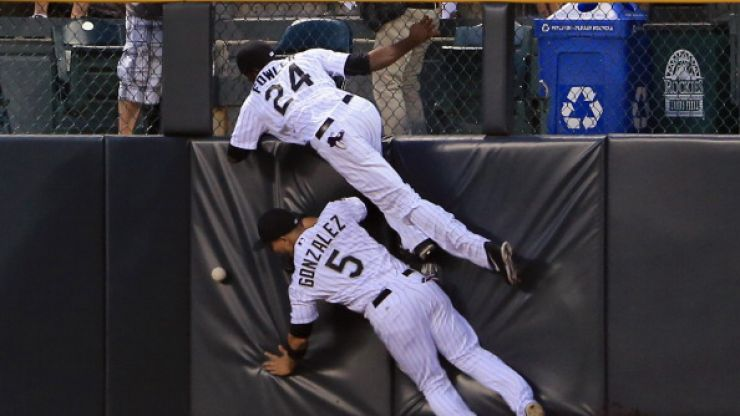 Video: Two baseball players chase high ball, crash into each other in comical fashion
