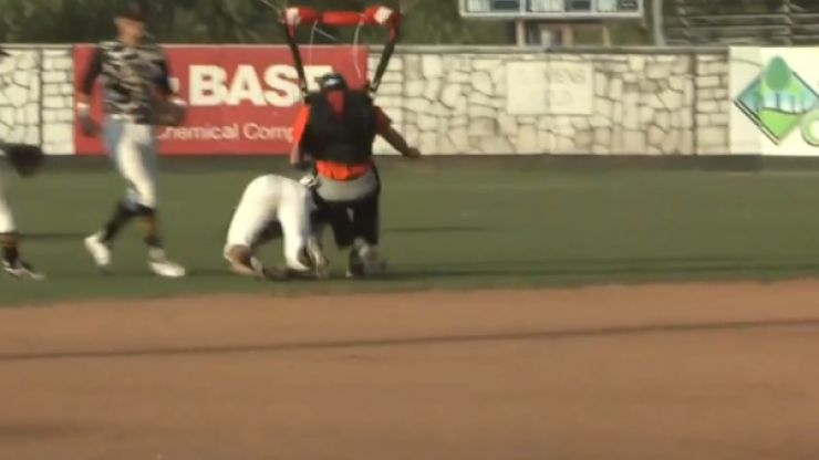 Video: Baseball player knocked out by dropkick from a skydiver