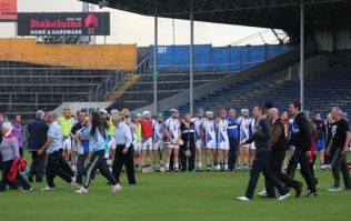 Pics: Fans at the Munster minor hurling final invade the pitch... before the game had even started