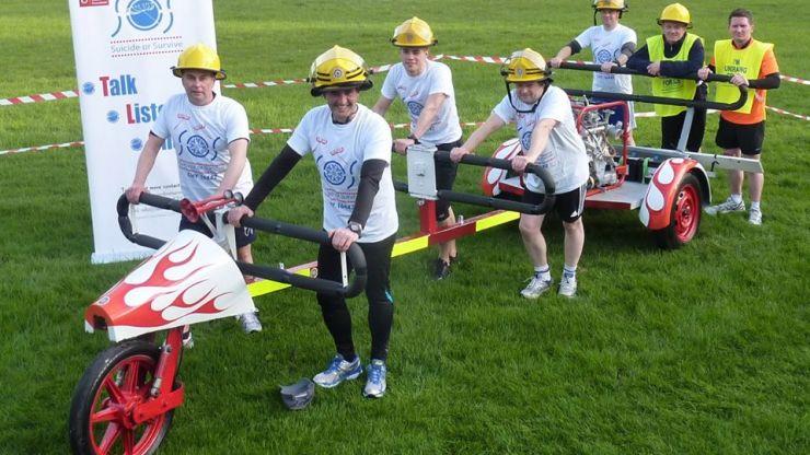 Dublin Fire Brigade gets set to run from Dublin to Belfast while pushing a half-tonne pump...