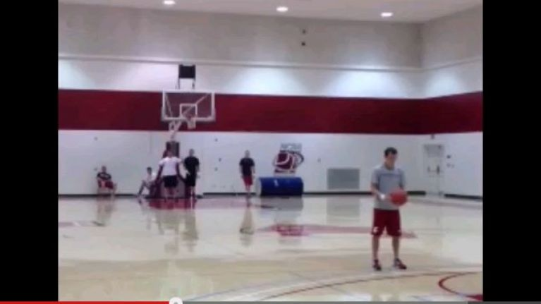 Video: Simply one hell of a basketball trick shot