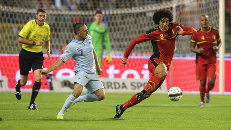 Pic: Mathieu Valbuena was surrounded by huge Kompany last night