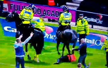 Video: Football steward trampled by police horse following pitch invasion