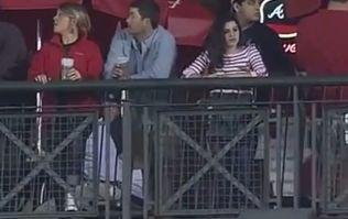 Video: Baseball fan caught on camera taking the phrase 'second base' literally with his missus