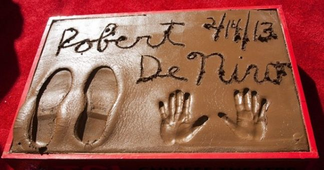 Robert De Niro gets his handprints on Hollywood Boulevard - surely he has done that already?