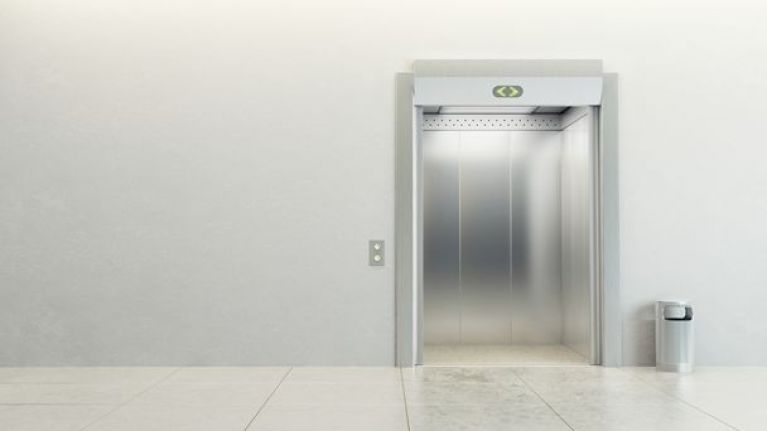 Health Minister James Reilly gets stuck in a lift