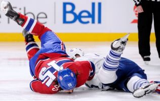 Video: The first fight of the NHL season didn't take long as George Parros is out cold