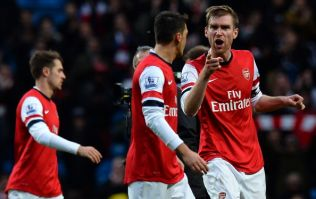 Mesut Ozil apologises to fans after getting an earful from Per Mertesacker