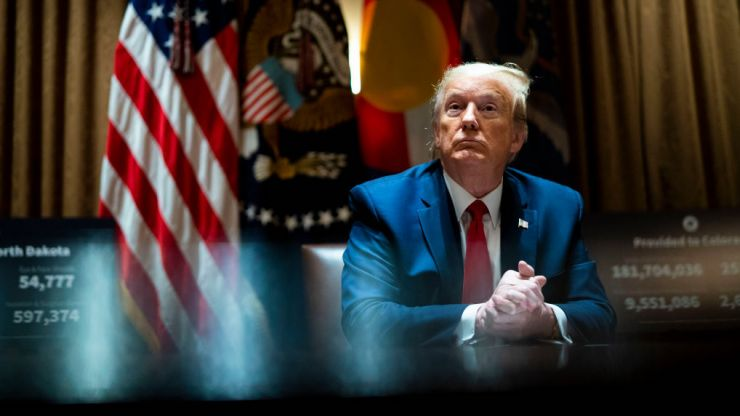 Trump says US topping world virus cases is a 'badge of honour'