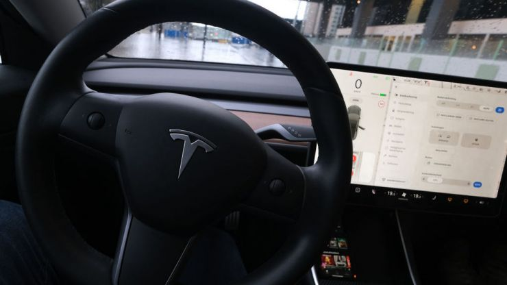 Two killed after Tesla car crashes with no one in driver's seat