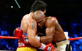 Pacquiao says Mayweather ran away from him, Mayweather calls Pacquiao a sore loser