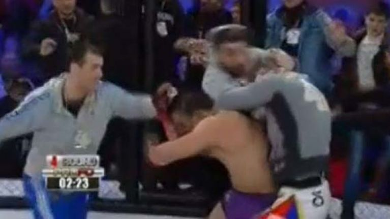 Video: Shocking scenes as flying knee KO sparks massive brawl at Russian MMA event
