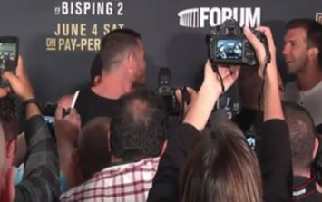 WATCH: Michael Bisping and Luke Rockhold have to be held apart during post-fight altercation