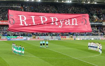 Northern Ireland fans and players observe impeccable minute's applause for Ryan McBride