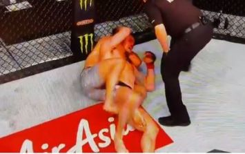 Georges St-Pierre chokes Michael Bisping unconscious to become UFC champion