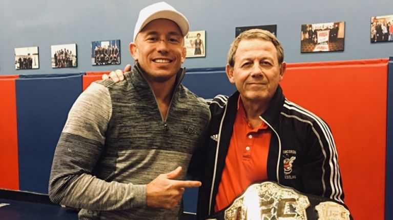 Georges St-Pierre gives new middleweight belt away to old wrestling coach