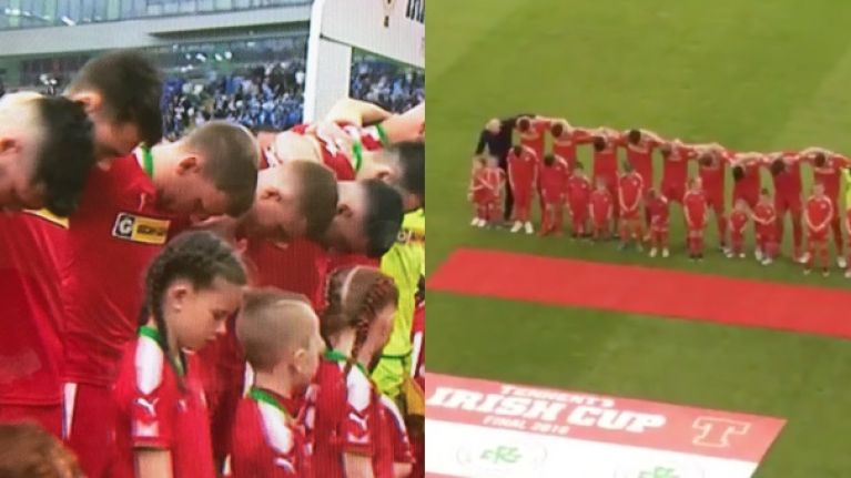 Cliftonville players keep their heads bowed during God Save the Queen before Irish Cup final against Coleraine
