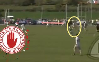 Tyrone 'keeper sells dummy, breaks three more tackles, kicks monster score