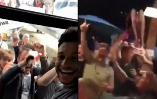 Alex Oxlade-Chamberlain is mobbed by fans while Carragher sings Salah song