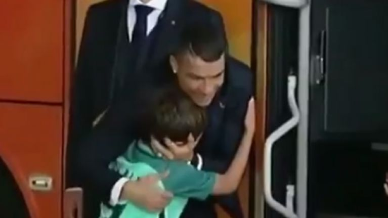 Young fan moved to tears after slipping by security and hugging Cristiano Ronaldo