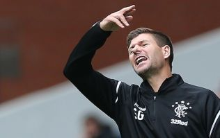 Steven Gerrard watches yet another Rangers player get sent off