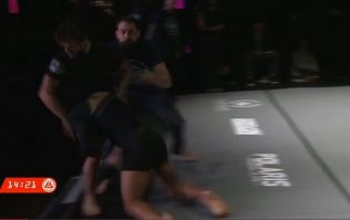 Benson Henderson sends referee and opponent flying off stage during jiu-jitsu match
