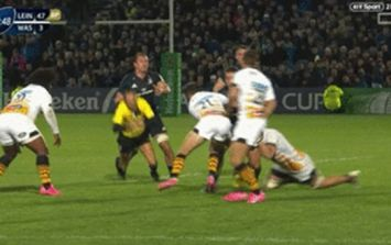 Leinster flanker Rhys Ruddock floors referee Romain Poite in back play
