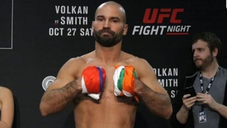 Artem Lobov stays true to his word and gives Michael Johnson his money back