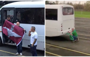 Ireland fan pins tricolour to back of Northern Ireland bus carrying Parachute Regiment flag